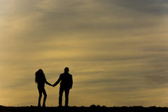 The silhouette of couple Stock Image