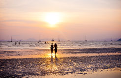 Silhouette of Couple Walking by the Beach Royalty Free Stock Image