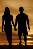 Silhouette couple walking hold hands Stock Photography
