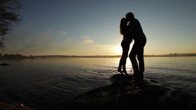 Silhouette of couples at sunset stock video footage