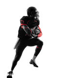 Silhouette courante de coureur de joueur de football américain photos stock