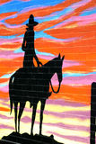 Silhouette of cowboy. Painted slhouette on brick wall of cowboy during sunset Stock Images