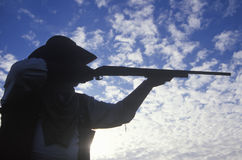 Silhouette of Cowboy aiming rifle Royalty Free Stock Photo