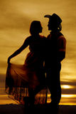 Silhouette cowboy couple hold dress facing Royalty Free Stock Image
