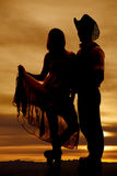 Silhouette cowboy couple hold skirt up Royalty Free Stock Photos