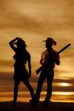 Silhouette cowboy cowgirl fun touch hat Royalty Free Stock Photo