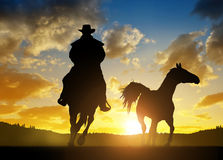 Silhouette cowboy with horse Royalty Free Stock Photos