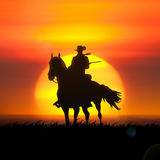 Silhouette of a cowboy on horseback. Stock Photo