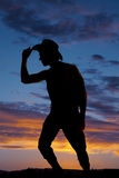 Silhouette of cowboy lean and touch hat Royalty Free Stock Image