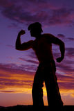 Silhouette cowboy no shirt flex muscles Royalty Free Stock Image