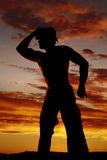 Silhouette cowboy no shirt hand on hat look to side Stock Images