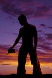 Silhouette cowboy no shirt hold hat down look side Royalty Free Stock Photo