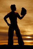 Silhouette cowboy no shirt look side hat out Stock Images