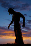 Silhouette cowboy no shirt side hands down Royalty Free Stock Image