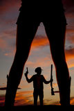 Silhouette of a cowboy shotgun in hand pistol up look side betwe Stock Photography