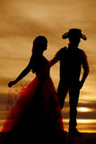 Silhouette cowboy and woman in dress Royalty Free Stock Images