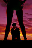 Silhouette of cowboy between woman legs in bikini Royalty Free Stock Image