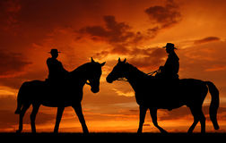 Silhouette cowboys. With horses in the sunset Royalty Free Stock Photos
