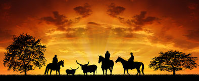 Silhouette cowboys stock photos