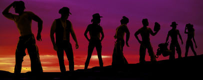 Silhouette of cowboys and cowgirls in a row Royalty Free Stock Photography