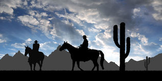 Silhouette cowboys. With horses in the sunset Royalty Free Stock Photo