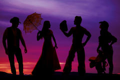 Silhouette of cowboys and women Stock Photography