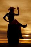 Silhouette cowgirl on barrel sit wave Royalty Free Stock Image