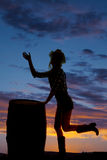 Silhouette cowgirl by barrel wave Stock Photos