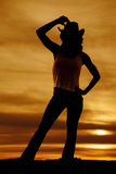 Silhouette of a cowgirl hand over hat Royalty Free Stock Photography