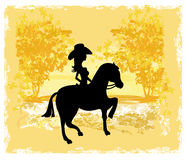 Silhouette of Cowgirl and Horse Stock Images