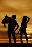Silhouette cowgirl rope hold hat royalty free stock photos
