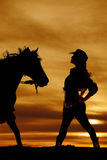 Silhouette of cowgirl side hands on hips Royalty Free Stock Photography