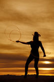 Silhouette cowgirl throw rope Royalty Free Stock Photo