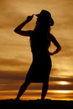 Silhouette of a cowgirl touch hat look to side Royalty Free Stock Photo