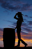 Silhouette cowgril by barrel hand on hat Stock Photography