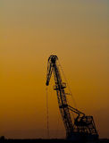 Silhouette of crane Stock Image