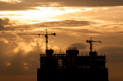 Silhouette of crane on building construction Royalty Free Stock Image