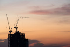 Silhouette of crane on building construction Royalty Free Stock Photo
