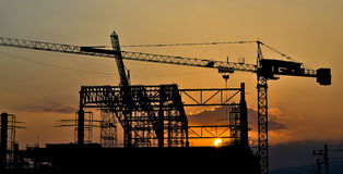 Silhouette crane building and sunset. Of Southeast Asia Royalty Free Stock Image