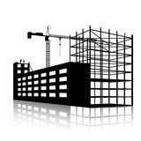 Silhouette of the crane and building under construction Stock Images