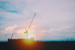 Silhouette of crane at construct site. Construction background Royalty Free Stock Images