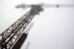 Silhouette of a crane and frame of a building royalty free stock photography