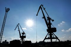 Silhouette of crane on port. With blue sky in background Royalty Free Stock Photo