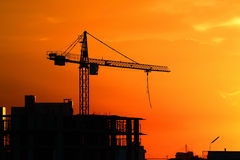 Silhouette Crane on Sunset Background Stock Images