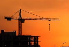Silhouette Crane on Sunset Background Stock Photos