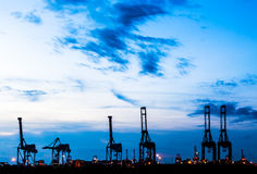 Silhouette of crane at trade port Royalty Free Stock Image