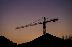 Silhouette crane with twilight sky Stock Images