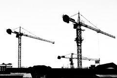 Silhouette crane working building. Black and white Royalty Free Stock Photo