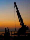 Silhouette crane working at port Stock Photo