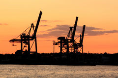 Silhouette of cranes in harbour Royalty Free Stock Images